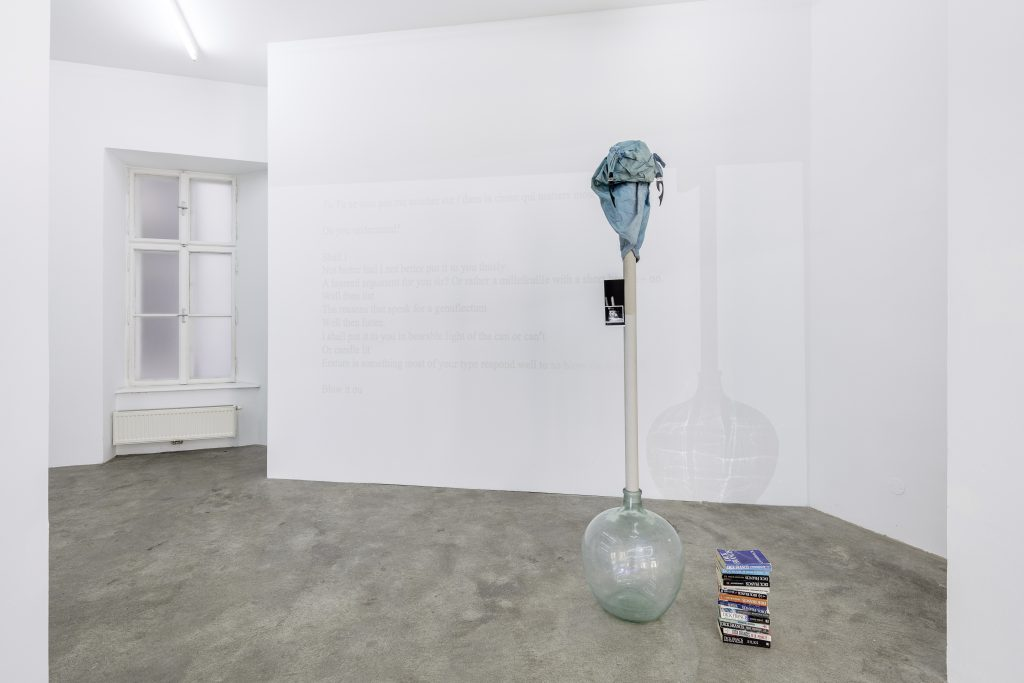 Sophie Jung, Spanische Hofreitschule, 2017, Horse mask, cardboard tube, xerox, acid bottle, stack of crime books, dimensions variable. Photography: www.kunst-dokumentation.com. Courtesy: Sophie Tappeiner